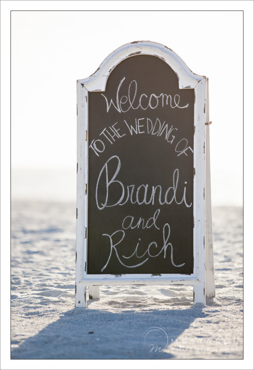 Beach wedding welcome sign at Pass-A-Grille Beach in St. Pete Beach, Florida.